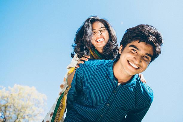 Young Indian couple Piggyback Playful Indian young couple Piggybacking romance stock pictures, royalty-free photos & images