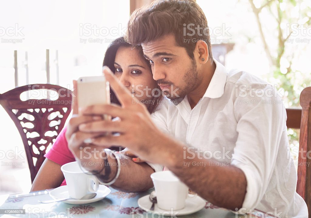 Young Indian Couple Taking a Selfie stock photo