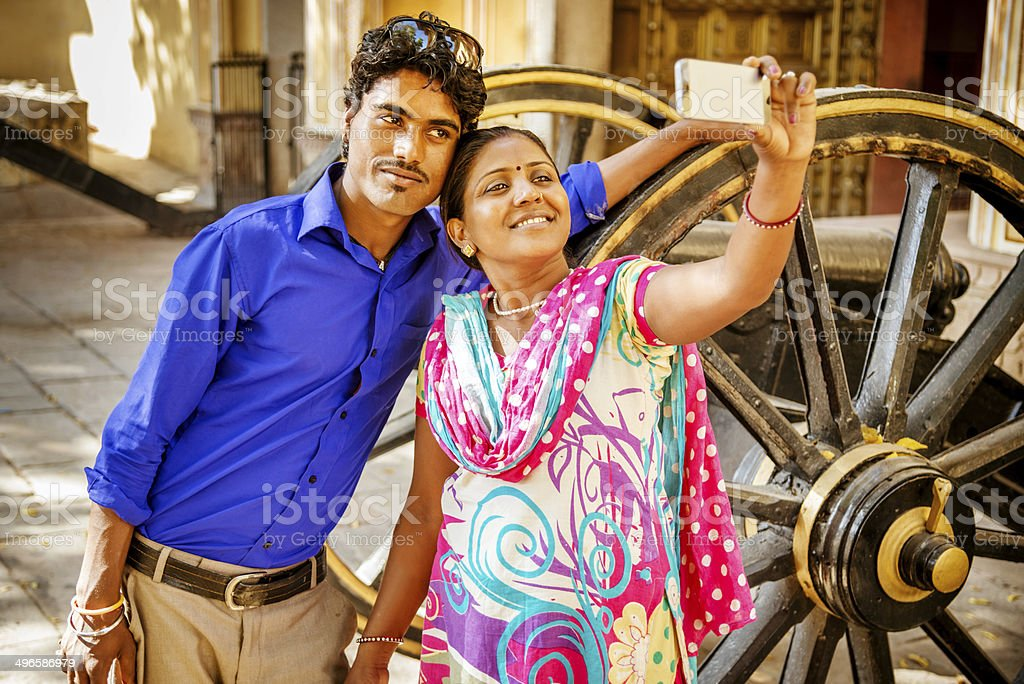 young indian couple taking a selfie royalty-free stock photo