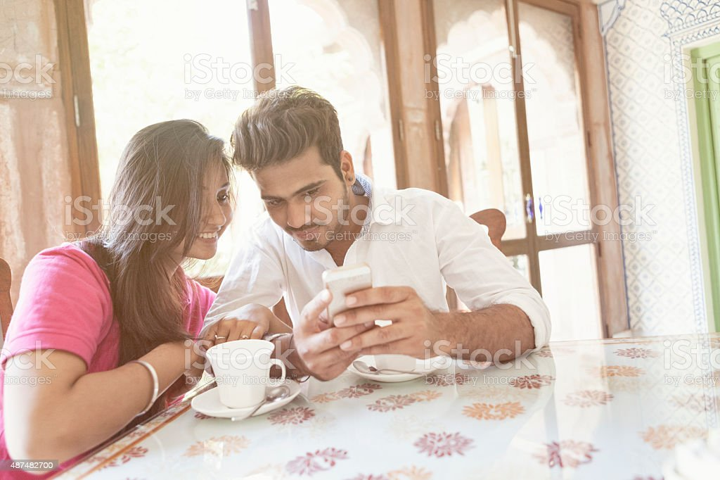 Young Indian Couple using a Smart Phone stock photo