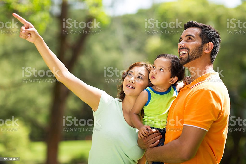 young indian family bird watching outdoors stock photo
