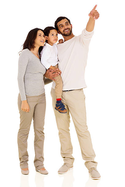 young indian family pointing stock photo