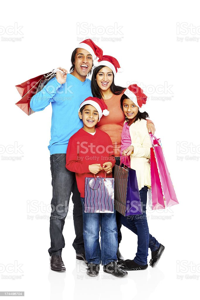 Young Indian family with Christmas shopping royalty-free stock photo