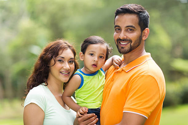 young indian family with the kid young happy indian family with the kid outdoors indian family stock pictures, royalty-free photos & images