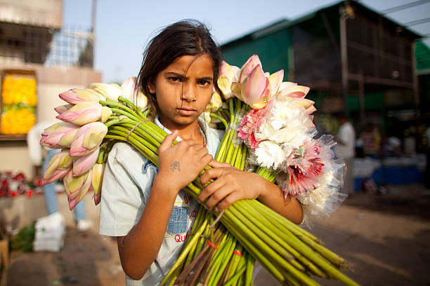 Young Indian flower vendor stock photo