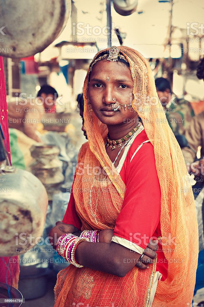 Young indian girl dressed in traditional rajasthan clothes. stock photo