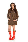 istock Young Indian girl wearing a coat and gumboots looking away 453844557