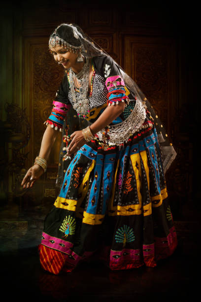 Young Indian Lady Performing Cultural Dance stock photo