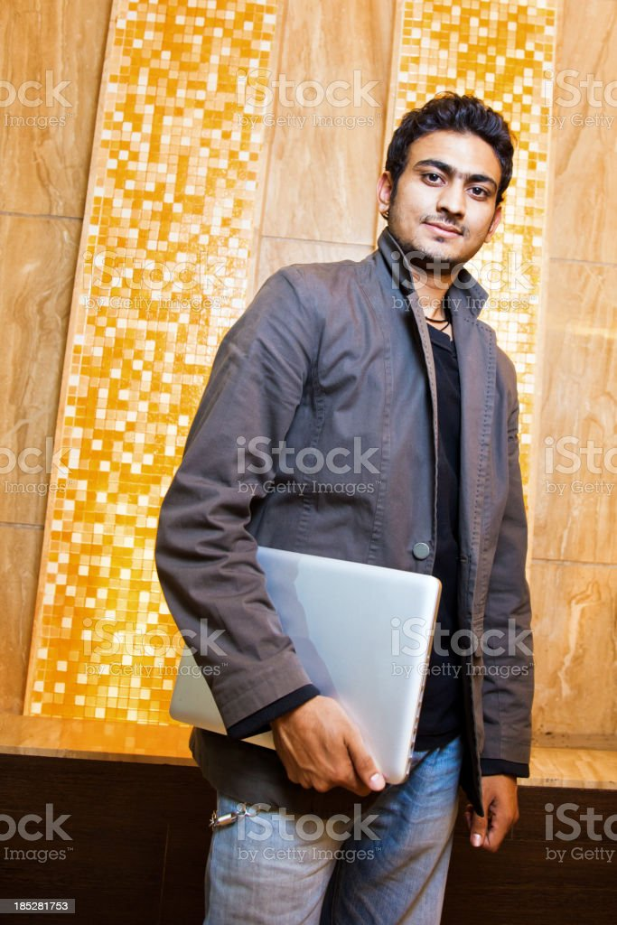 Young Indian Male with Laptop royalty-free stock photo