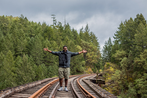 istock Young Indian Man at Goldstream Trestle 1217656433