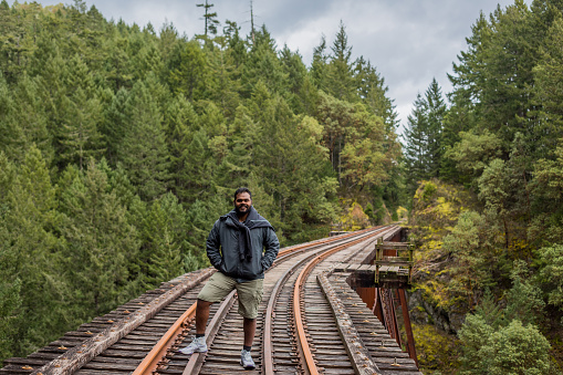 istock Young Indian Man at Goldstream Trestle 1217657320