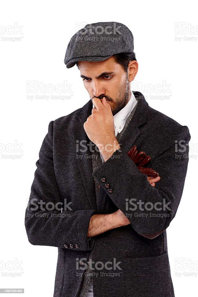 young indian man looking down thinking stock photo more pictures