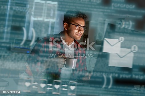 istock Young indian man received message from dating app 1077503934