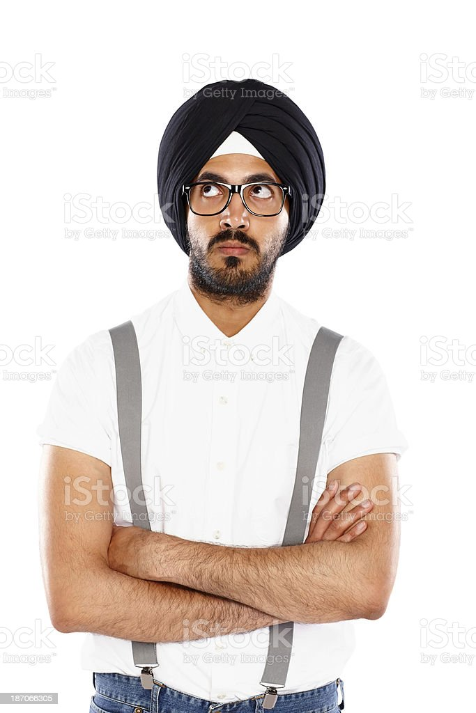 Young Indian man standing on white looking away royalty-free stock photo