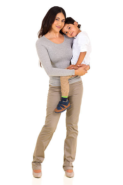 young indian mother holding her son stock photo