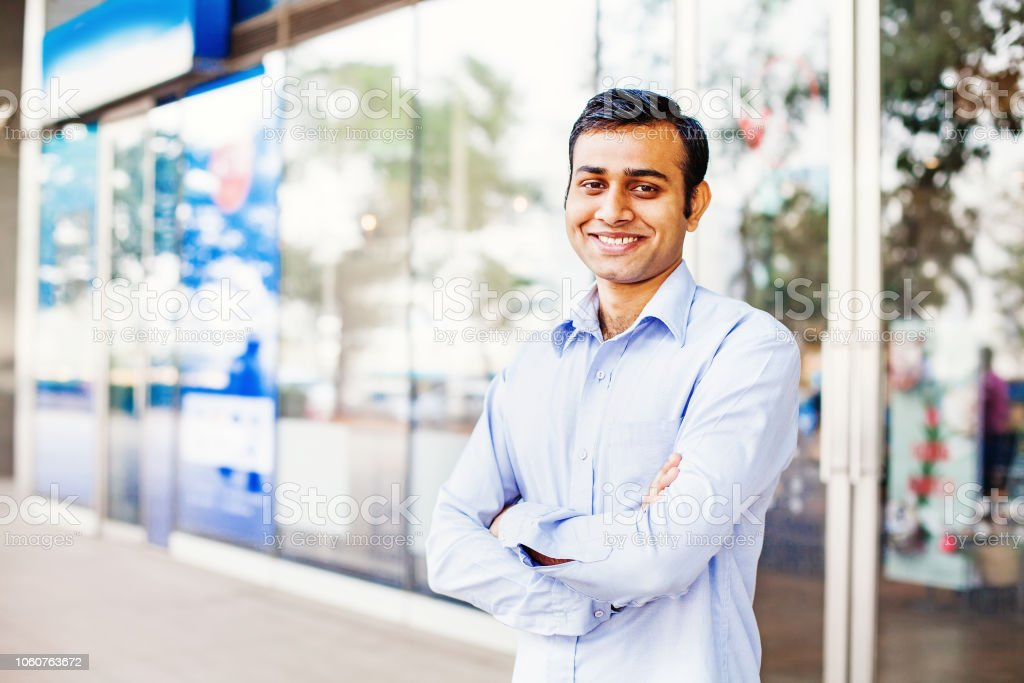 Young indian office worker looking at camera stock photo