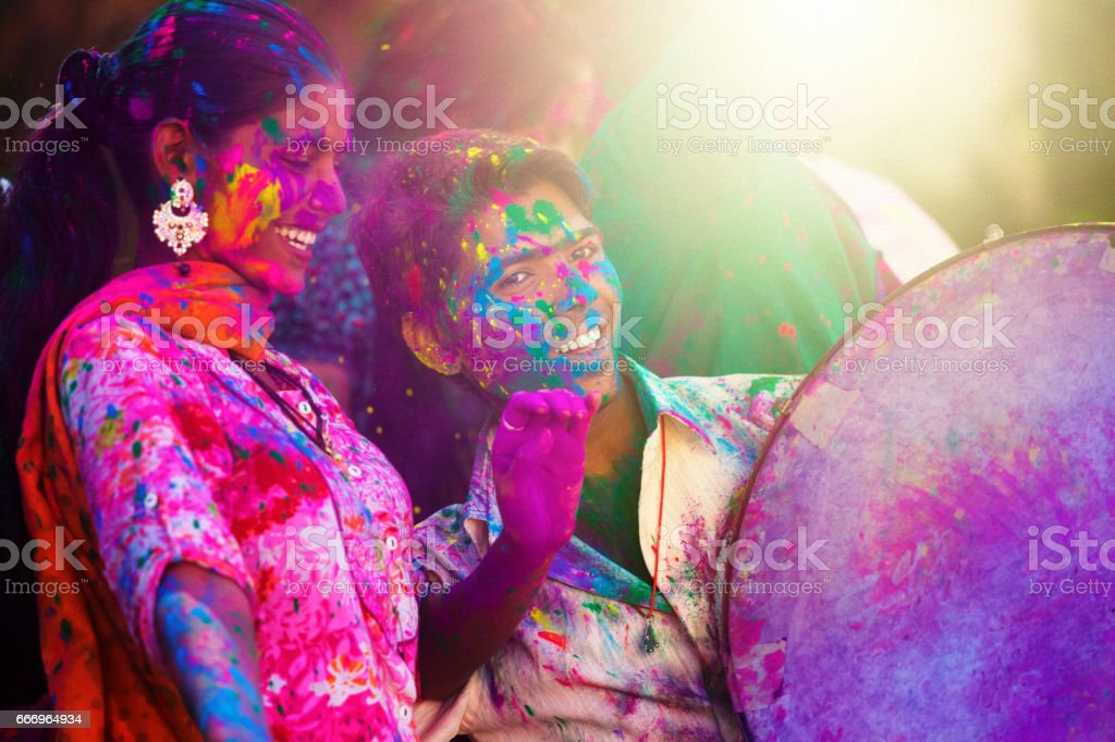 young indian people at holi celebration stock photo