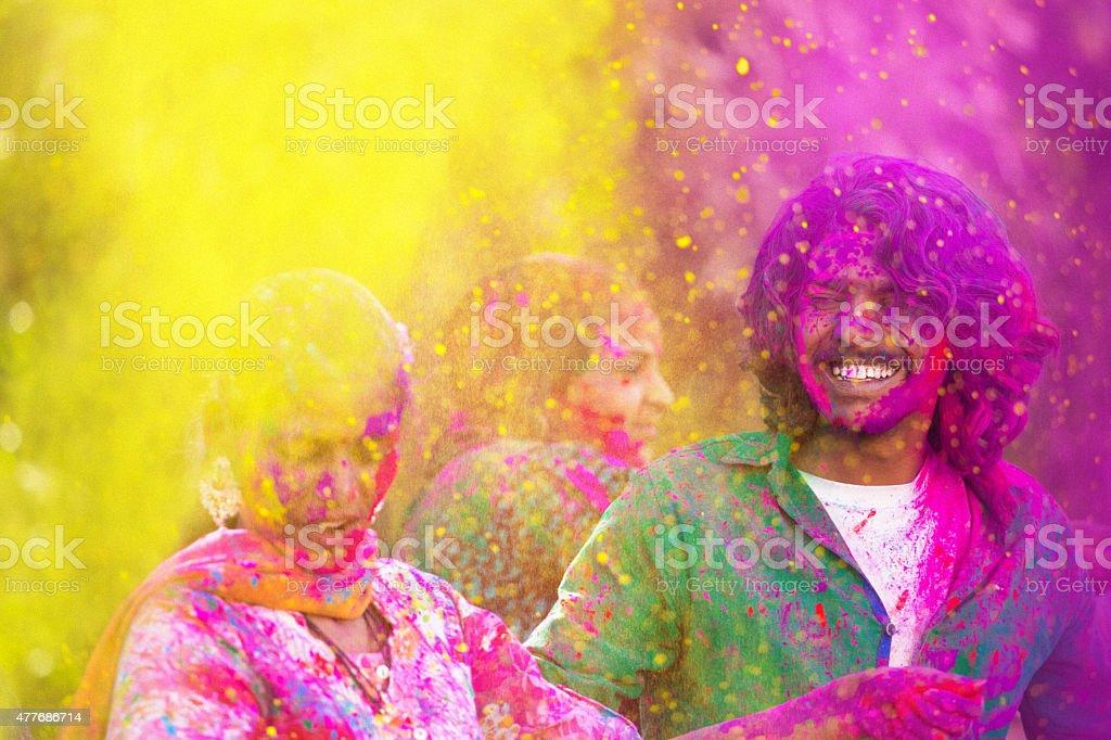 young indian people celebrating holi festival stock photo