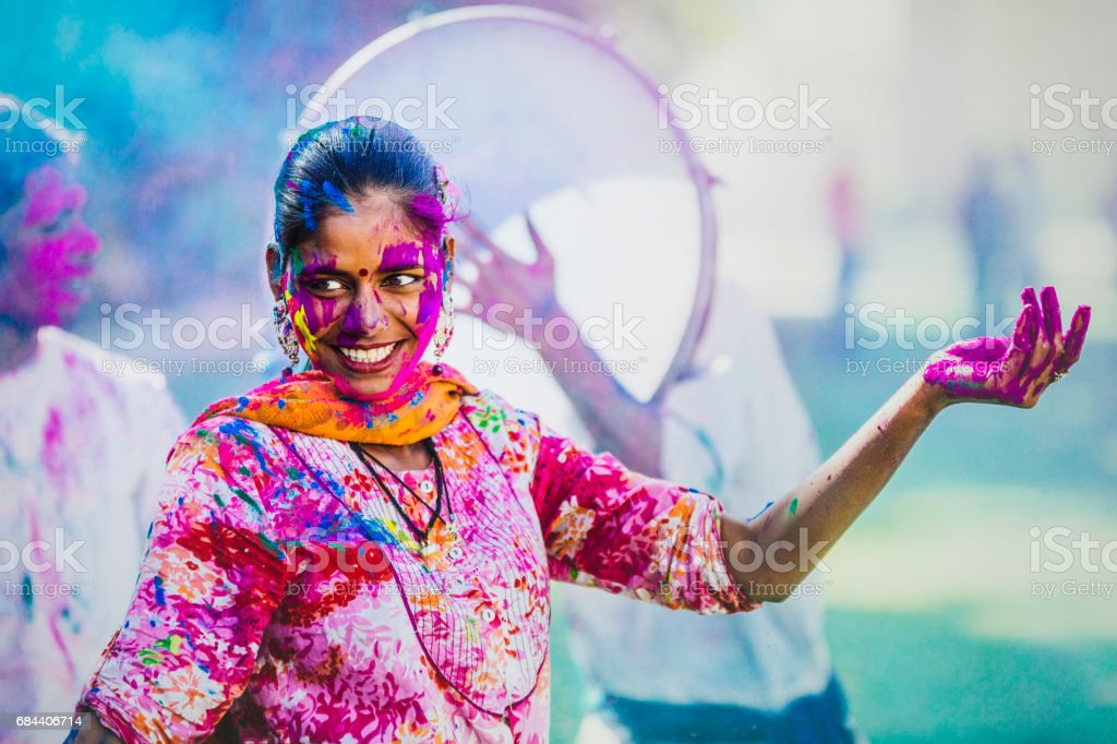 Young Indian people, with their colorful faces and clothes, celebrating the Holi Festival celebration in Jaipur India. stock photo