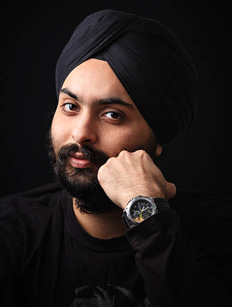 Young Indian Sikh looking at camera stock photo