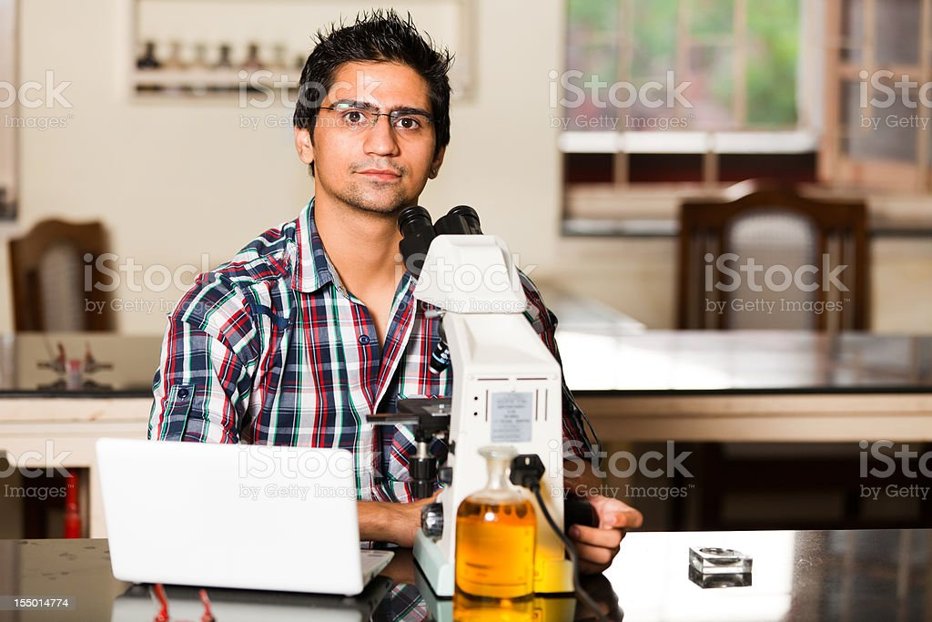 young indian student in a lab stock photo