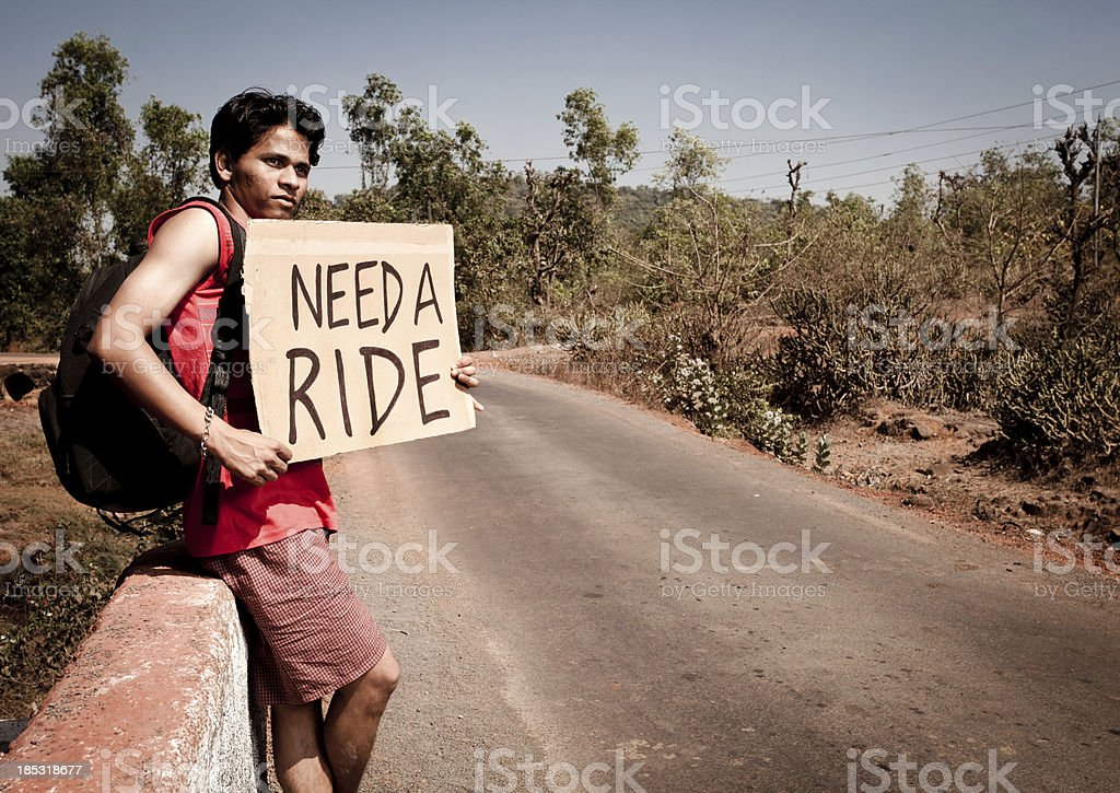 Young Indian Tourist Traveler man needs a ride hitch royalty-free stock photo