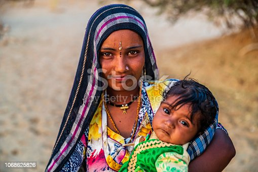 Young Indian woman with her baby. Thar Desert, Rajasthan, India.