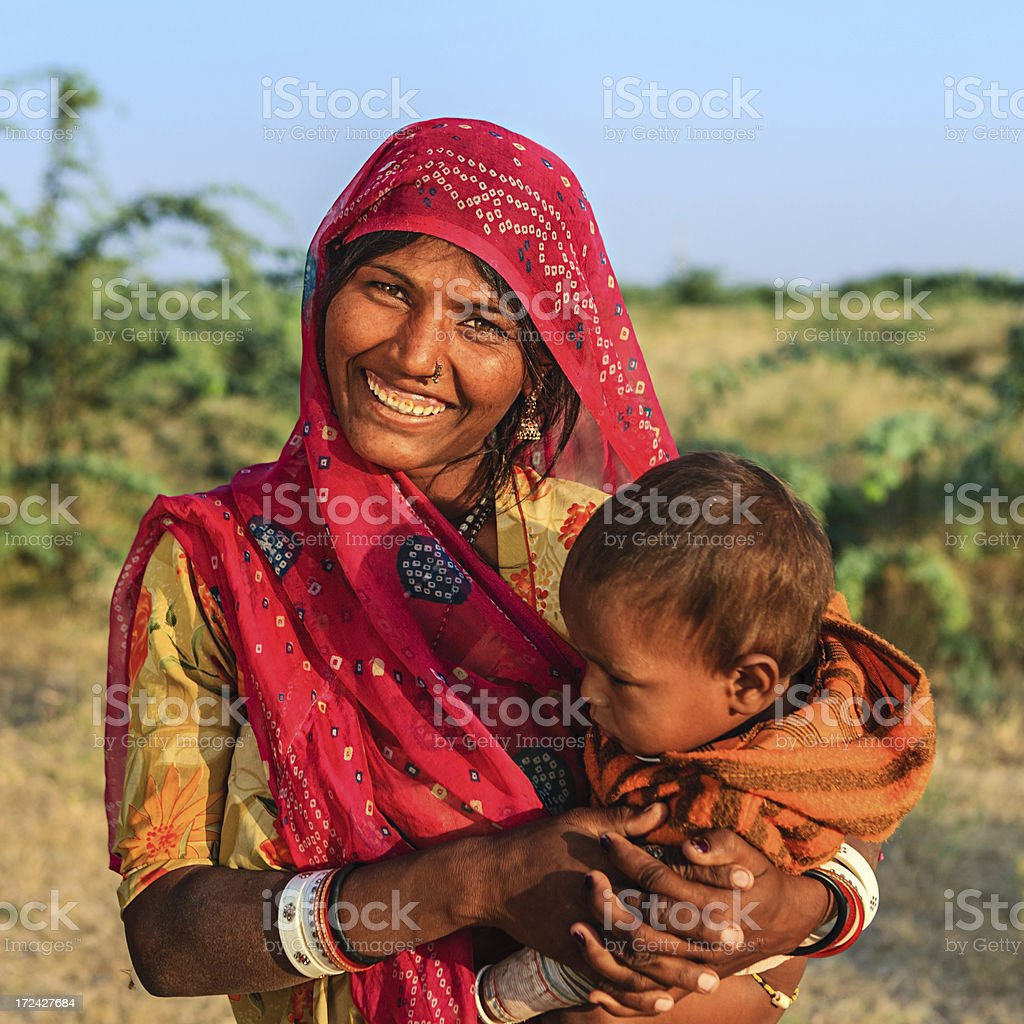 Young Indian woman holding her baby royalty-free stock photo