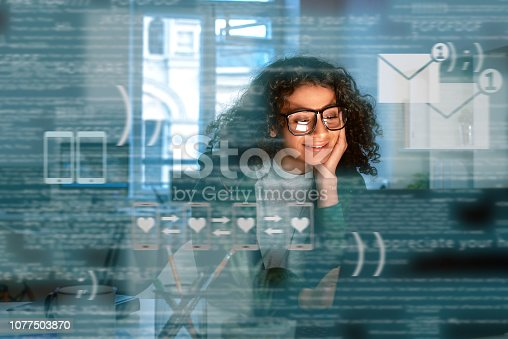istock Young indian woman received message from dating app 1077503870