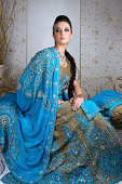 istock Young Indian Woman Wearing Traditional Ornate Dress 108176565