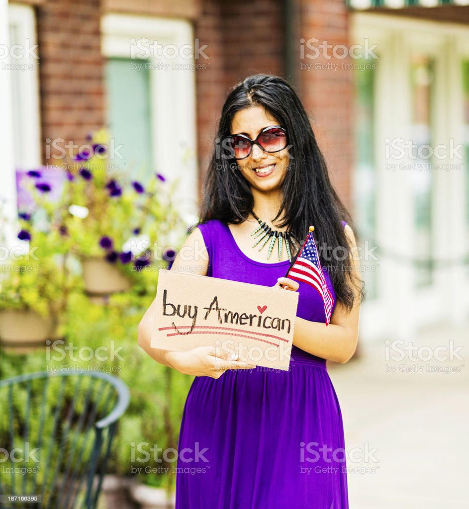 Young Indian Woman with Buy American Sign royalty-free stock photo