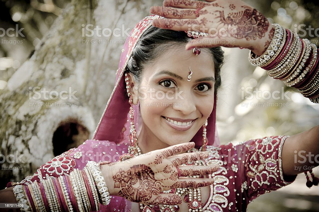 Young Indian woman with henna and a traditional dress stock photo