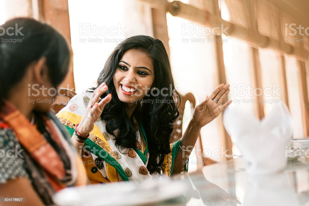 Young Indian Women Dining Together stock photo