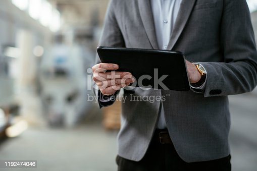 Close up of businessman in factory