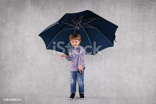 young insurance agent under umbrellas, copy space