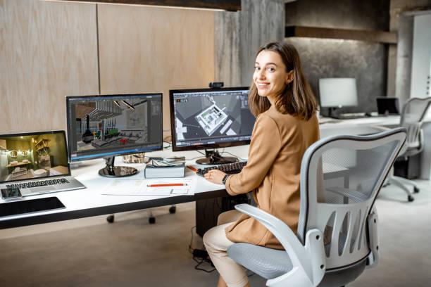 joven diseñador inteiror que trabaja en la oficina - arquitecta fotografías e imágenes de stock