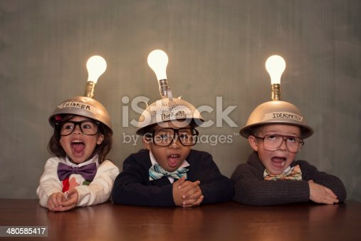 istock Young Intelligent Children Nerds wearing Thinking Caps 480585417