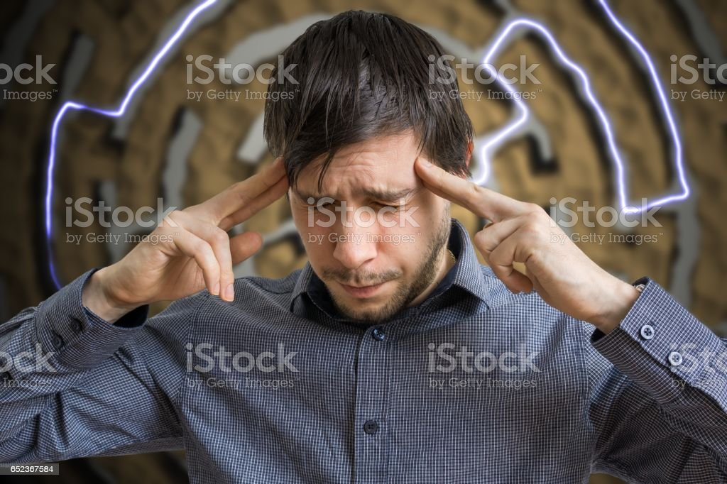 Young intelligent man is thinking and looking for solution for difficult task. stock photo