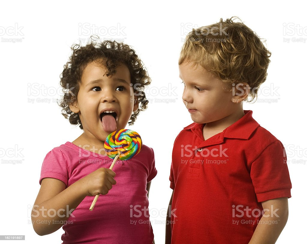 Interacial Ele young interacial children with rainbow colored candy stock photo