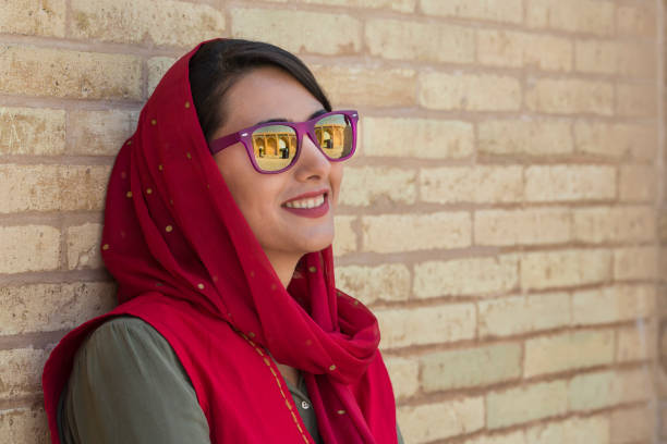 young iranian woman with sunglasses and headscarf, isfahan, iran - iranische stock-fotos und bilder