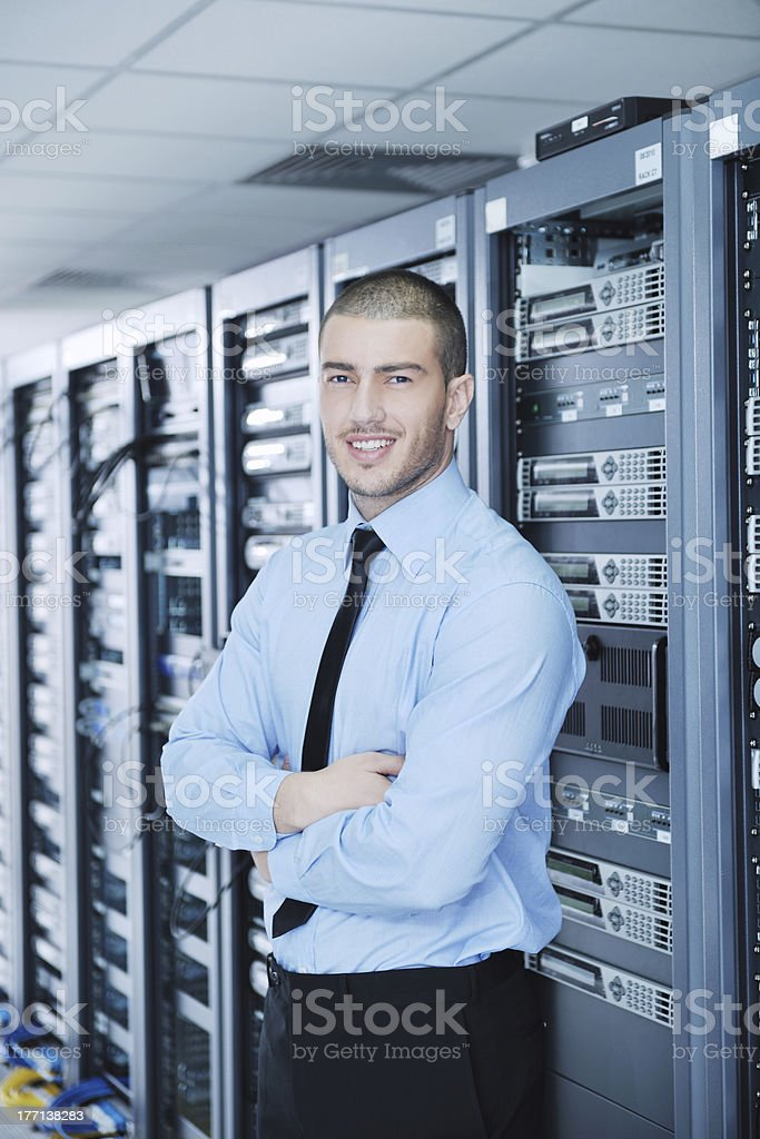 young it engineer in datacenter server room royalty-free stock photo