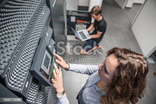 Young IT Engineers Working in Supercomputer Electricity Backup Room.