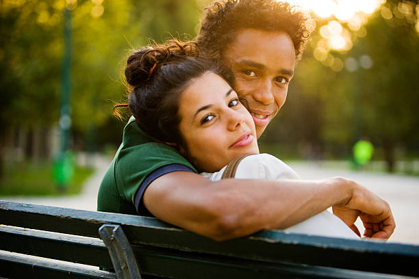 Young Italian Couple relaxing in park stock photo