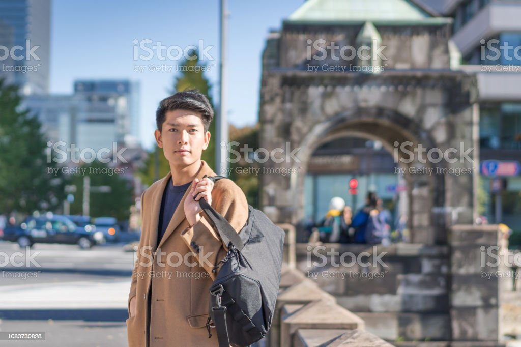 Young japanese and asian friend looking for travel location using...