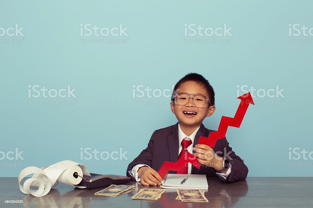 Young Japanese Boy Has Growing Business stock photo