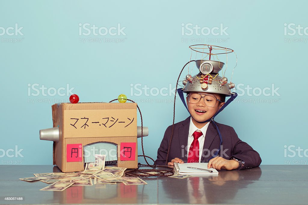 Young Japanese Boy in Business Suit Makes Money stock photo