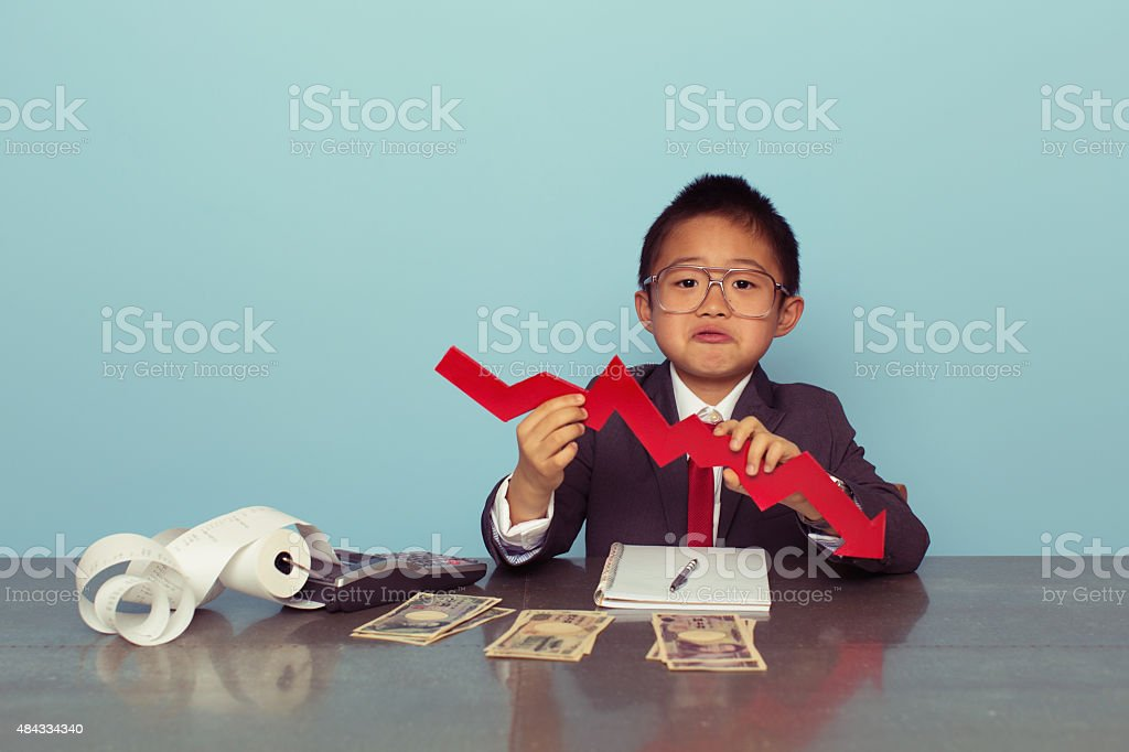 Young Japanese Boy Is Losing Money stock photo