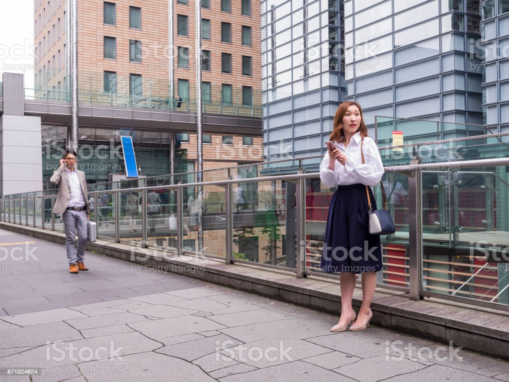 Young Japanese business woman waiting for her business partner. stock photo