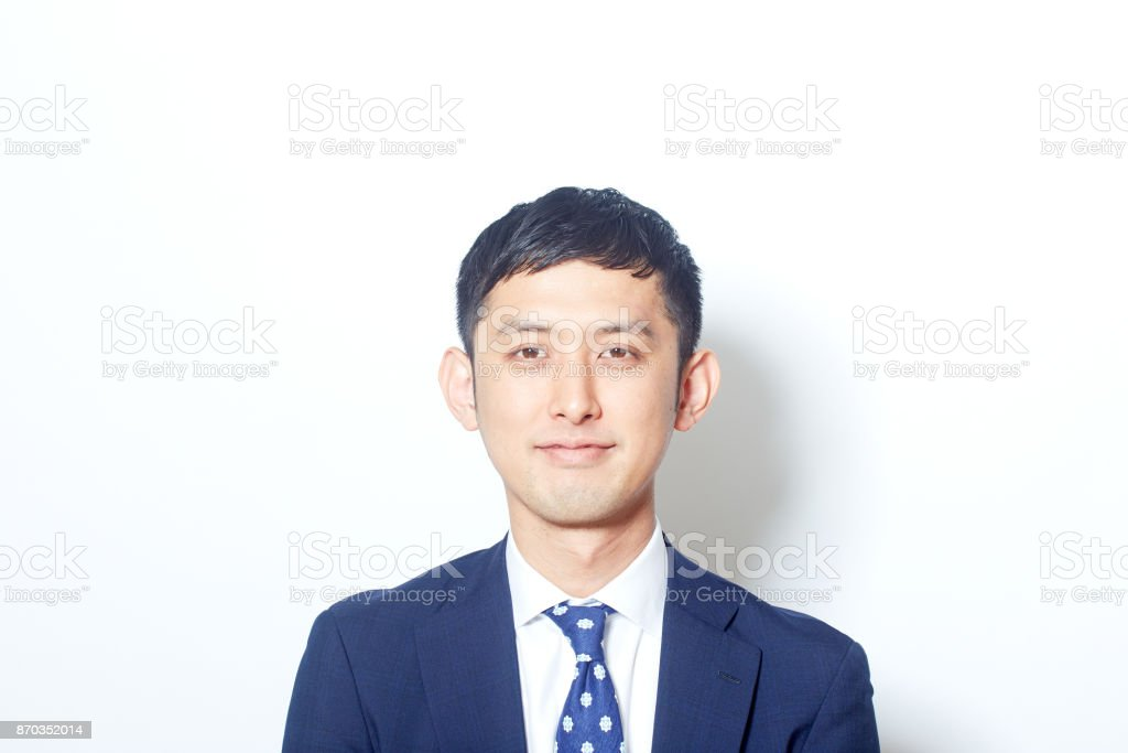 Young Japanese businessman in a suit looking at the camera stock photo