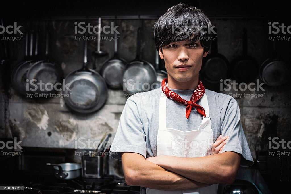 Young Japanese Chef in the Kitchen. stock photo